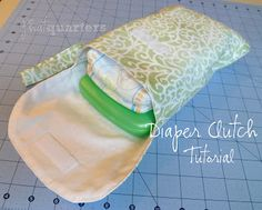 Phat Quarters Blog: Diaper Clutch Tutorial (I like the idea of a small carabeena clip, not a strap & a second strip of velcro on the body of the bag for extra full days)