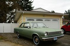 OLD PARKED CARS.: 1966 Rambler American 220.
