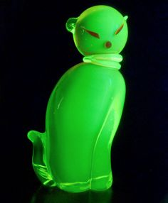 Large Salviati Murano hand blown sommerso vaseline glass cat in orange and yellow glowing green with uranium under the black light, Venice, Italy, 20th Cent.