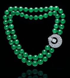 An exclusive double-strand jadeite bead and diamond necklace.