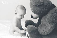 Six month old baby boy with teddy bear
