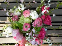 The flowers from the garden included pink and white ranunculus, green florets of Snowball Viburnum, Pink Impressions Tulips, Hellebore, small  flowering branches of  Bridal Wreath Spirea and Pink Flowering Almond.