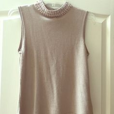 Petite Beaded Neckline Top Perfectly beaded tight fitting neckline. Full beading around. Has 3 clasps at the back of the neck, but they can be worn open. 85% seda 15% cashmere. Great condition but it has been worn. The size/brand tag is falling off but is still there! Tag says large but I think I fits more like a medium. Kasper Tops Blouses