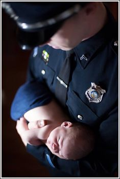 Wilmington Police Officer with new son Wilmington, Delaware Rhonda Bowman Photography ©