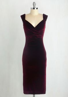 Who wouldn't want to croon a ballad when they see you in this sultry frock? In a melodic, shimmering maroon velvet material that caresses your curves, this dress complete with a crossover sweetheart neckline and gentle pleats at the bust, is made to impress. Step into your favorite jazz club for a martini and dulcet serenade!