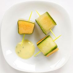 """Cucumber-Melon """"Sushi"""" - Cut cantaloupe into 16 cubes, about 1 inch each. Use a vegetable peeler to slice 16 long strips of cucumber. Wrap strips around melon cubes and insert a toothpick. Stir together 6 ounces plain yogurt, 2 tablespoons orange-juice concentrate, and a teaspoon of chopped cilantro for a dipping sauce."""