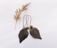Brass leaf earrings / long metal earrings / by laviniasboutique