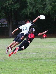 Students dive for a Frisbee in Ultimate Frisbee. (Repinned)