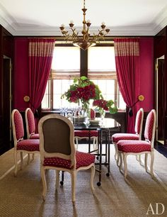 A 1920s Austrian gilt-bronze chandelier is suspended above a Jansen dining table in this Dining Room