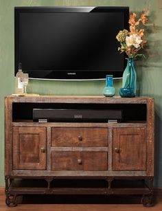 "Urban Gold 52"" TV Stand. Solid wood with mortise and tenon construction. $725."