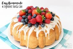 Homemade Vanilla Cake is the easiest recipe ever- just 4 ingredients & it tastes divine! I like to top this cake with berries & a sweet almond glaze.