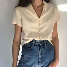 Super chic styling of a high waist jean and white blouse.
