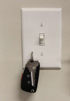 Place strong magnet behind switch plate to hang keys
