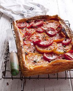 "Bill Granger's <a href=""http://www.goodfood.com.au/good-food/cook/recipe/tomato-tart-20121123-29u9v.html?rand=1383274507501""><b>heirloom tomato tart</b></a> packs a double tomato punch."