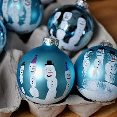 Cute Christmas Craft - Paint kids' hands and have them hold the ornament; fingerprints become snowmen! Or elves or Mr. and Mrs. Santa...