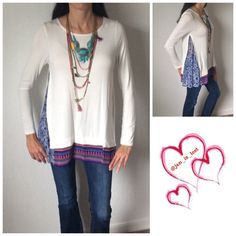 ❄️️Sale❄️ Long Sleeve w/Printed Accent This is a soft white top with bright accent piece at the bottom of the top and on the sides.  This is true to fit (women's sizes) and new without tags. Material is 95% Rayon and 5% Spandex. Tops