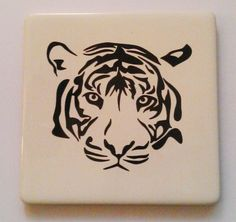 Tigers face vinyl tile coaster. Tiger Face, Tile Coasters, Tigers, Handmade Gifts, Creative, Cards, Kid Craft Gifts, Handcrafted Gifts, Hand Made Gifts