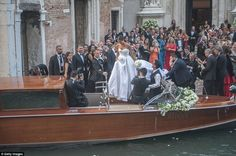 Queen for a day: The tennis player looked majestic as she stepped down into the rose-decorated water taxi with all eyes watching