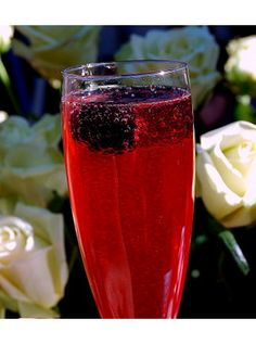 3/4 oz blackberry simple syrup  1-1.5 oz. gin  Sparkling wine    It's bubbly :)