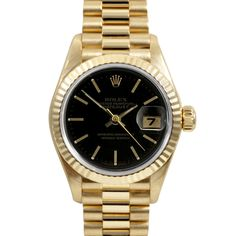 This stunning women's pre-owned Rolex President's watch features an 18-karat yellow gold case with a matching bracelet. The black dial is home to factory hands and stick markers with a date window at 3 o'clock.