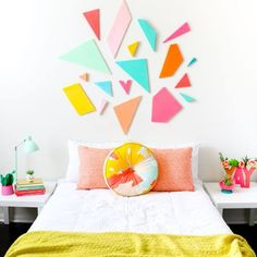 This would be great for a kid room // Learn how to DIY your own light weight colorful geometric headboard using craft foam sheets by FloraCraft. Easy triangle and polygon shaped bedroom decor - quick craft - home DIY project