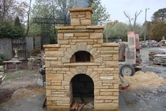 Fireplaces and Masonry Ovens - McGraw Hardscapes outdoor fireplace with pizza oven