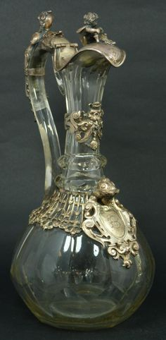 Antique Austro-Hungarian Empire cut glass claret pitcher clad with silver overlay