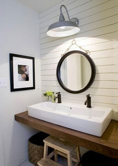 bathroom mirror - love the round and the light over it. Also love the white plank wall behind. Totally doable for our new bathroom.