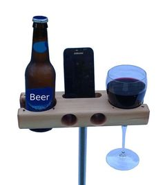 The Beverage Dock - perfect for a gift.  Smartphone Dock/Speaker and Wine Glass, Beer Bottle, Cup holder. works with iphone 5c and iphone 5s... @VinoPlease #VinoPlease
