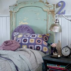 Crochet pillow, awesome headboard, and the wainscoting! I love the number 2 just hanging out on the ledge.