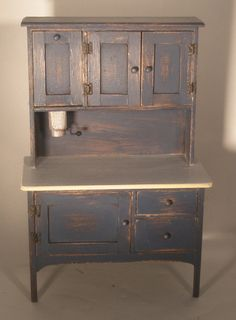 Hoosier Cupboard just got mine sanded down after I painted it black...not sure if I will keep it that color