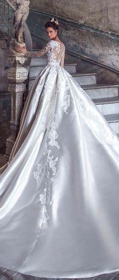Long sleeves illusion neckline heavy embellishment ball gown wedding dress #weddingdress #weddinggown #bridaldress