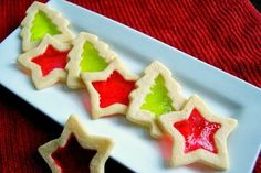 These Stained Glass Cookiesare rolled sugar cookies cut out and filled with crushed Jolly Rancher candies which melt and create a stained-glass effect.