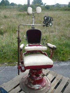 Antique 1900s? hydraulic Barber/Optometry/Physician Chair w child booster seat.  I think Belding may still have this... ;)