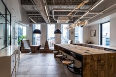DRAFT Inc. has completed the design of their offices located in Osaka, Japan. The design uses the same furniture and materials as the Tokyo head office Booth Seating, Stone Tiles, Commercial Design, Modern Industrial, Osaka, White Walls, Space Saving, Offices, Dining Table