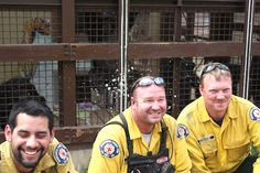 """The Chimpanzee Sanctuary Northwest sends big thanks to all of the firefighters for their continued and tireless work on the Taylor Bridge fire. Jamie chimpanzee """"baptized"""" them with some cooling water (see the water droplets)."""