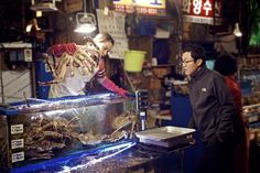 Life at the Original Noryeongjin Fish Market ... A vendor grabs and weighs a king crab for a customer at Koreas largest fish market in Seoul. . . . . #Seoul #fishmarket #korea #travel #seafood #ig_seoul #ig_korea #food #market #life #history #old #VisitSeoul #natgeotravel #bbctravel #cntraveler #thedecisivesketch #kingcrab #crab #deadliestcatch