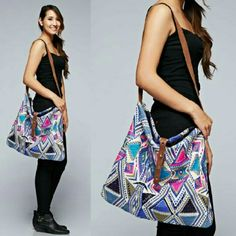 Hayley Handbag A triangle print design cross body handbag, embellished with a leather closure and a contrast canvas strap.  Fabric: 60% Cotton, 30% Polyester, 10% Wool Bags Crossbody Bags