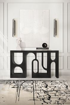 Cosmopolitan and modern, this minimalistic-looking hallway can and will bring peace to your state of mind. The CYRUS Wall Light paired with the INK Rug from Rug's Society, will be the perfect adjacent pieces to the astonishingly unique COLOSSEUM Console in black.