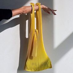 Yellow lightweight pleated bag made from biodegradable corn based PLA (Polylactic Acid Fiber) Two straps with tie closure To maintain pleats, empty the bag after use Hand wash, do not tumble dry 22 x 30 inches Made in Fukui, Japan From KNA Plus Diy Fashion, Fashion Bags, Fashion Design, Lv Bags, Purses And Bags, Sacs Design, Diy Vetement, Clutch, Mellow Yellow