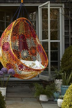 Unbelievably Relaxing Piece Of Furniture Hanging Chair: Beautiful Stunning Outdoor Hanging Chair Bohemian Feel Made Of Colorful Pattern Mesh With Simple Soft White Throw Pillows ~ buymyshitpile.com Chairs Inspiration