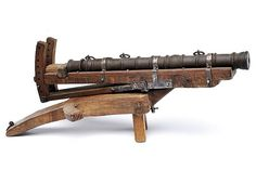 """A siege-cannon model Czerny's International Auction House. Cylindrical, iron barrel with moulded muzzle, mouldings, vents at the base, flat breech with three rings; on a tripod, turning and adjustable, with iron mounts. In the style of 15th Century.Illustrated in """"Armeria della Rocca di Verucchio"""", by M. Mauro (Adriapress, Ravenna, 2007); page 91, top right.provenance: Italydimensions: length 51 cm. dating: 20th Century"""