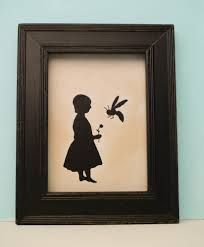 Sweet little girl! Love the black frame!
