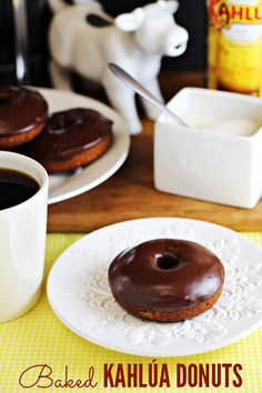 Baked Kahlúa Donuts - homemade donuts without the deep frying! Kahlúa coffee liqueur is baked right in, plus added to the chocolate glaze.