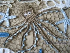 A lovely little octopus and other sea creatures, done in Irish crochet