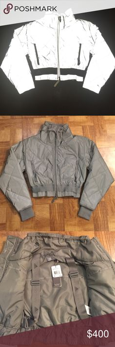 NWT Stella McCartney Jacket Rare!!! Sold out EVERYWHERE.. So cute!!! Size small.. Very feminine and outrageous coat!! 3M Reflective Material Throughout! I love this coat but if you want it you can have it I have not worn it yet! I paid $400 for this including tax Adidas by Stella McCartney Jackets & Coats Puffers