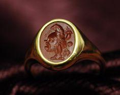 Intailles / Intailles romaines / Intaille romaine montée en bague or. Grylle.