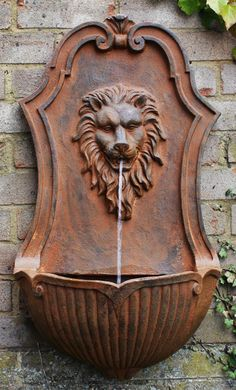 Fuente de pared León