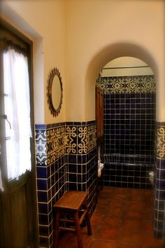 Antique doors, handmade tile, for rustic style!!, This is the master  bathroom in our second home here in San Miguel de Allende. I love having the ability to design a space that is so different from my home in Portland, Carole www.carolemeyerart.com, This house is made of adobe and the walls are all very thick. The floors are saltillo tile...the tiles were hand painted here in San Miguel. The French doors open to a small balcony. , Bathrooms Design