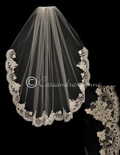 The first 20 inches of this lace wedding veil is embroidered. A beautiful flower Alencon lace trims the rest. A few pearls decorate the flowers and leaves. It i